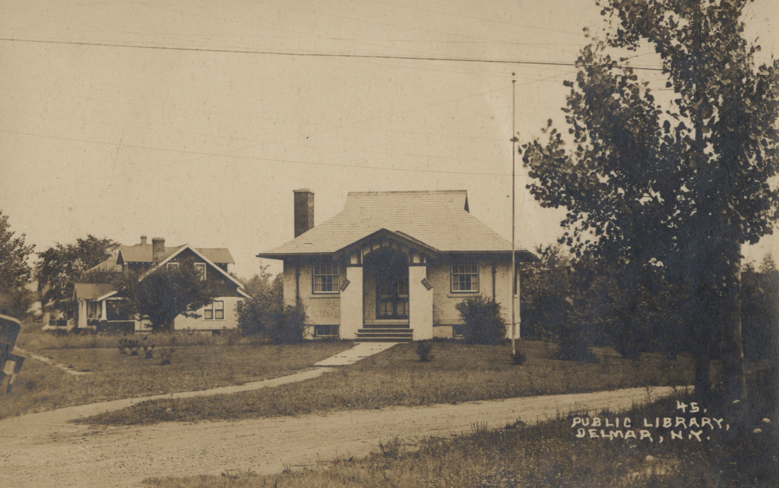 Sepia toned photo of Delmar Free Library in 1925